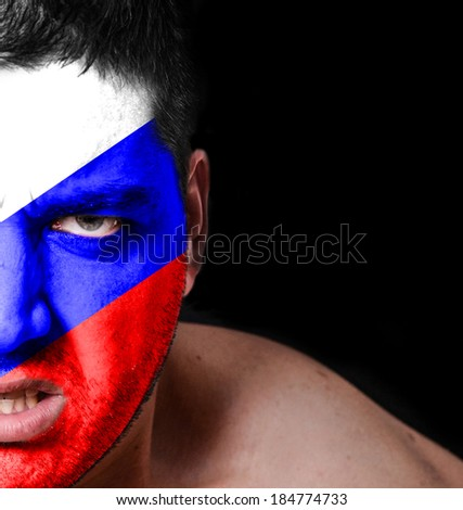 Portrait of angry man with painted flag of Russia - stock photo