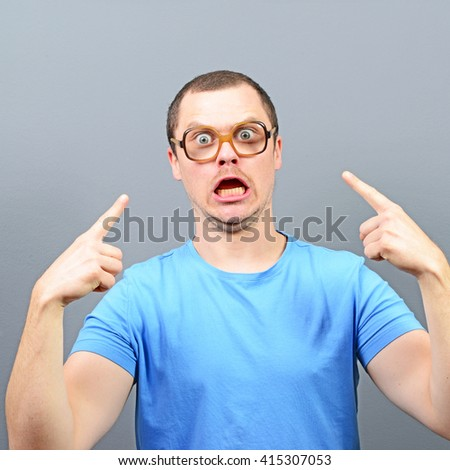 Portrait of angry nerd with huge glasses - stock photo