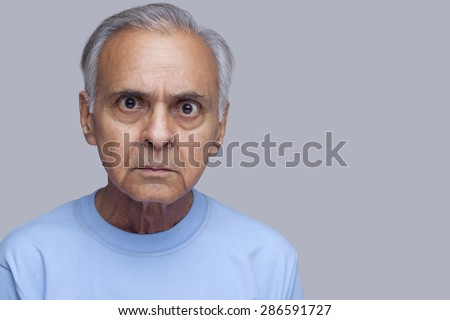 Portrait of angry old man - stock photo