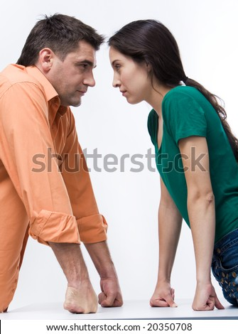 Portrait of angry people looking at each other during conflict - stock photo