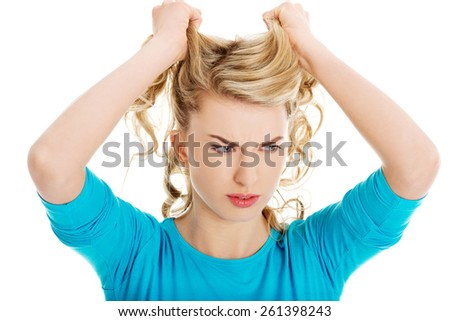 Portrait of angry woman pulling her hair. - stock photo