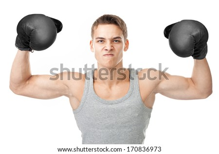 Portrait of angry young boxer showing biceps isolated on white background - stock photo