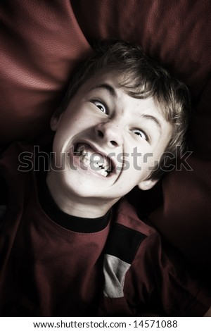 Portrait of angry young boy - stock photo