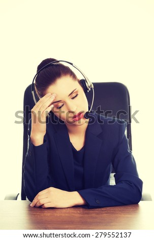 Portrait of anoyed support phone operator in headset - stock photo