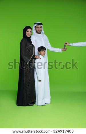 Portrait of Arab family taking keys - stock photo