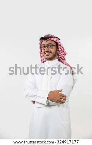 Portrait of Arab man with arms crossed - stock photo
