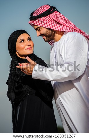 Portrait of Arabic dressed yang couple. - stock photo