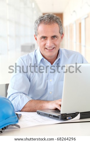 Portrait of architect working in the office - stock photo