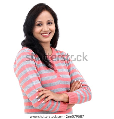 Portrait of arms crossed young woman against white background - stock photo