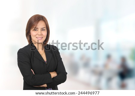 Portrait of asia business woman 30-40 year old in her office.Mixed Asian / Caucasian businesswoman.Positive emotion - stock photo