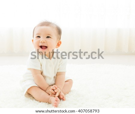 portrait of asian baby isolated in the room - stock photo