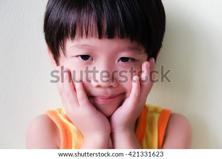 Portrait of asian boy on white background with copyspace - stock photo