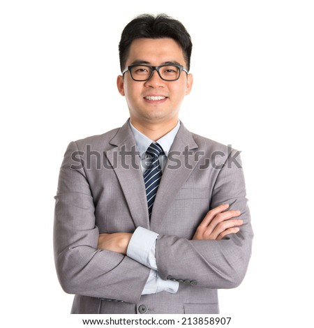 Portrait of Asian business man arms folded smiling, standing isolated on white background. - stock photo