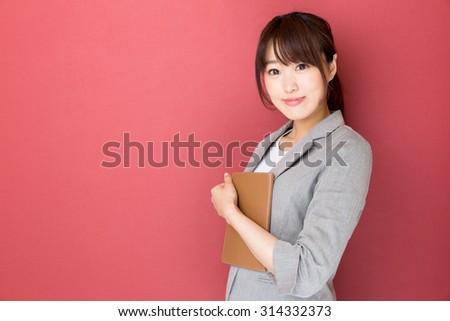 portrait of asian businesswoman isolated on red background - stock photo