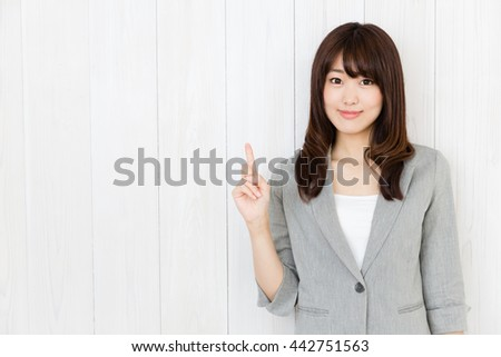 portrait of asian businesswoman isolated on wood background - stock photo