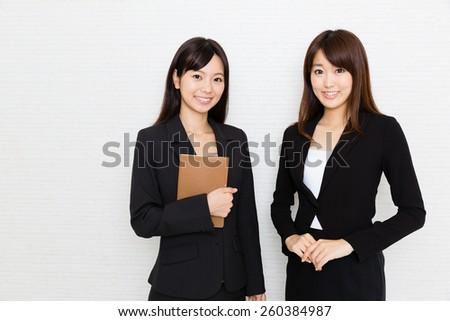 portrait of asian businesswomen on white background - stock photo