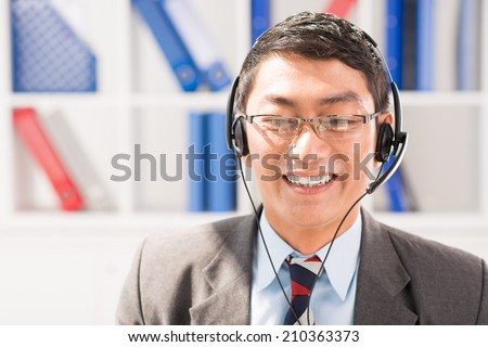 Portrait of Asian customer service agent - stock photo