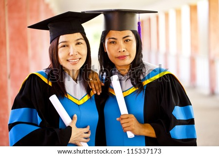 Portrait of Asian graduating students. - stock photo