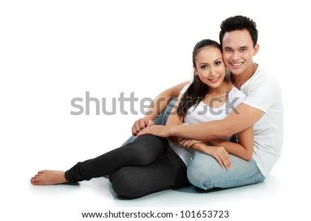 portrait of asian happy couple smiling on white background - stock photo