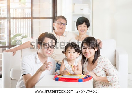 Portrait Of Asian Multi Generation Family - stock photo