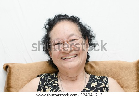 Portrait of asian senior woman happy expression - stock photo