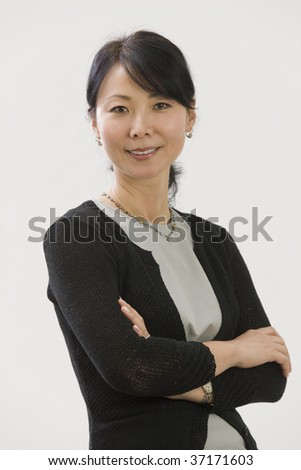 Portrait of Asian woman executive - stock photo