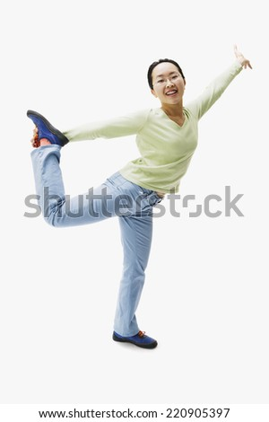 Portrait of Asian woman holding leg up - stock photo