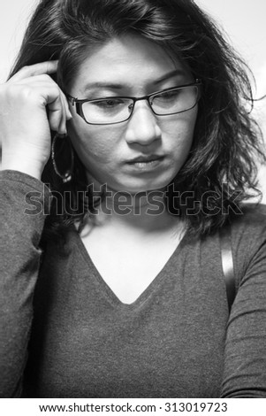 Portrait of asian woman or lady thinking and pondering for business background - stock photo