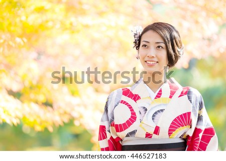 portrait of asian woman wearing japanese traditional kimono in autumn - stock photo