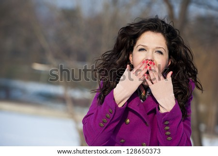 Portrait of astonished smiling young woman - stock photo