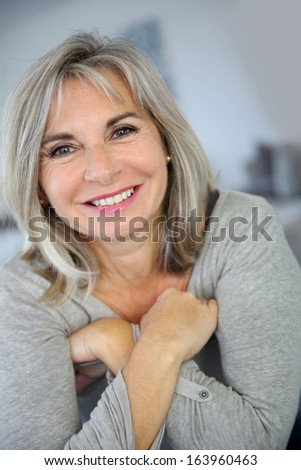 Portrait of attractive and serene mature woman - stock photo