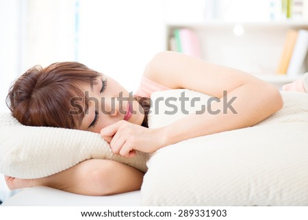 Portrait of attractive Asian girl sleeping on bed. Young woman indoors living lifestyle at home. - stock photo