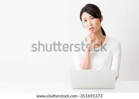 portrait of attractive asian woman isolated on white background - stock photo