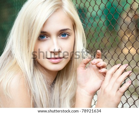 Portrait of attractive beautiful blonde girl with blue eyes - stock photo
