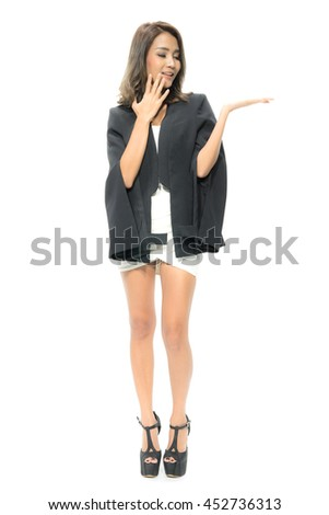 Portrait of attractive Beautiful Young Asian Businesswomen smiling happy presenting with open hand showing empty copy space.  Female model isolated on white background. - stock photo