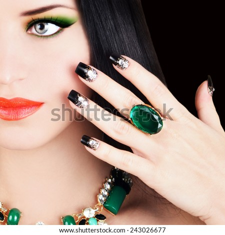 Portrait of attractive brunette beauty with long healthy hair and perfect makeup and jewelry.  - stock photo