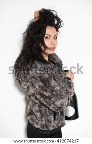 Portrait of attractive brunette posing with a big bottle - stock photo