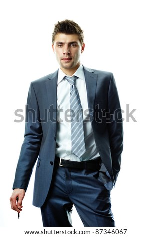 Portrait of attractive businessman in suit looking at camera - stock photo