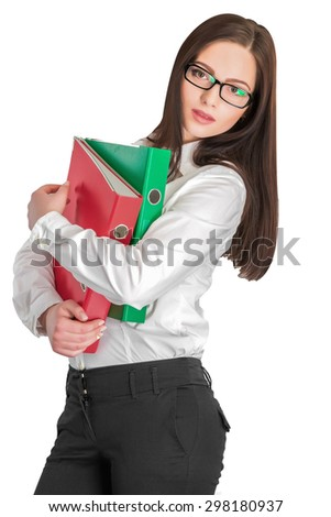 Portrait of attractive businesswoman in glasses holding red and green folders isolated on white background   - stock photo