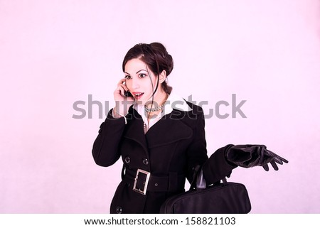 portrait of attractive businesswoman talking on cell phone - stock photo