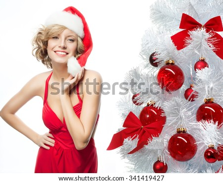 portrait of attractive  caucasian smiling woman blond isolated on white studio shot in santa's hat and red dress  new year tree red balls - stock photo