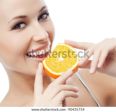 portrait of attractive  caucasian smiling woman isolated on white studio shot eating orange - stock photo