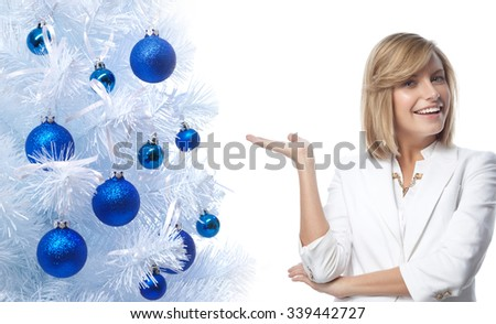 portrait of attractive  caucasian smiling woman isolated on white studio shot looking at camera  hand new year christmas tree balls - stock photo