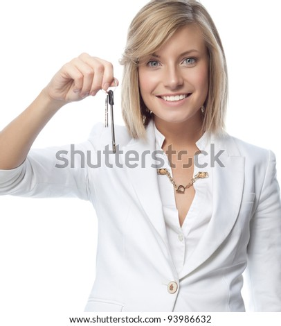 portrait of attractive  caucasian smiling woman isolated on white studio shot looking at camera with keys - stock photo