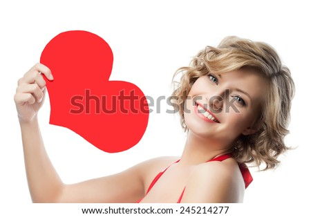portrait of attractive  caucasian smiling woman  isolated on white studio shot with heart - stock photo