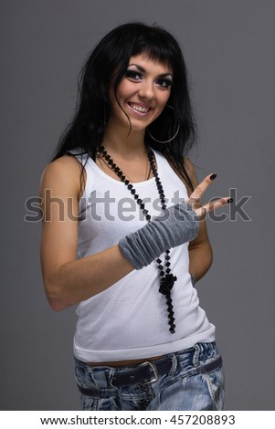 portrait of attractive caucasian smiling woman on gray background, studio shot - stock photo