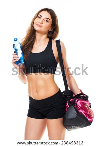 Portrait of attractive caucasian smiling woman with bottle of water and sports bag isolated on white background - stock photo