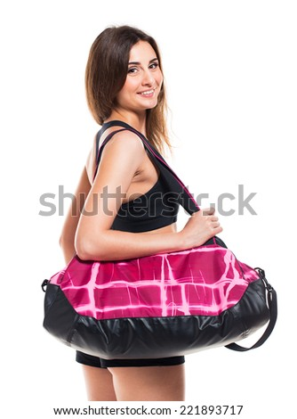 Portrait of attractive caucasian smiling woman with sports bag isolated on white background - stock photo