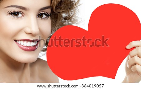 portrait of attractive  caucasian smiling young woman blond isolated on white studio shot red heart valentine's love - stock photo