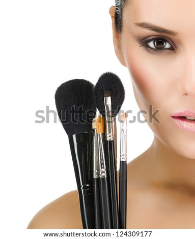 portrait of attractive  caucasian  woman brunette isolated on white studio shot face closeup makeup brushes - stock photo
